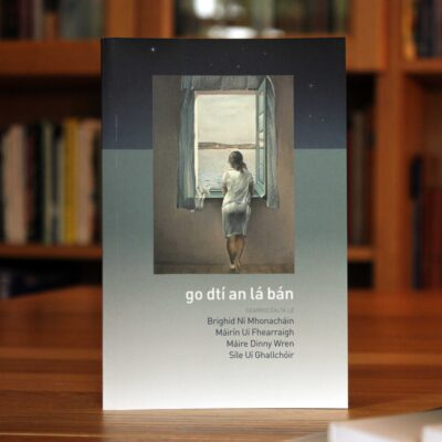 Cover of Go dtí an lá bán showing a Dali painting of a woman at a window